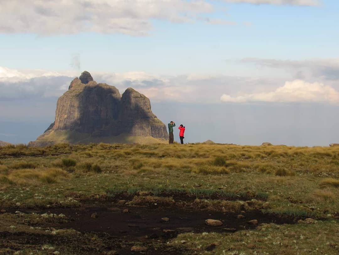 In front of Cathedralk Peak, with Drakensberg Hiker